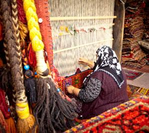 Carpet-weaver at work